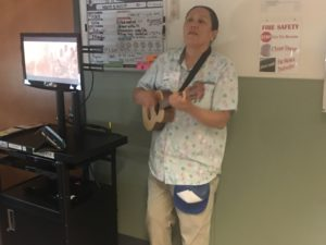 KIMMER HORSEN plays ukulele and guitar for the patients at SHRINERS HOSPITAL